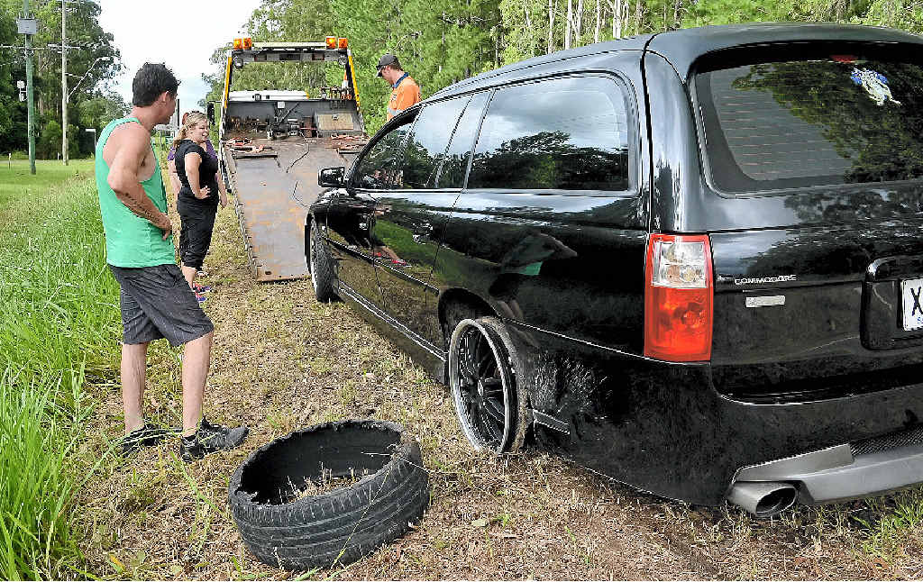 TYRE TROUBLE: Natasha Griffin (inset) blew a tyre when she hit a pothole on Steve Irwin Way. ABOVE: A car busted a wheel a few hundred metres away yesterday.