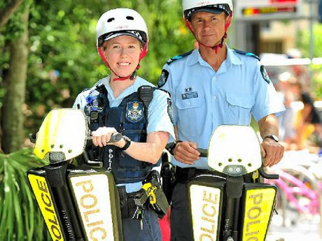ON THE BEAT: Constable Karina Hawkins (left) and Senior Constable Pierre Senekal on their segways in Hastings St, Noosa.