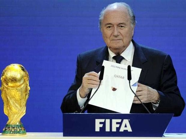 FIFA President Sepp Blatter holding up the name of Qatar during the official announcement of the 2022 World Cup host country at the FIFA headquarters in Zurich.