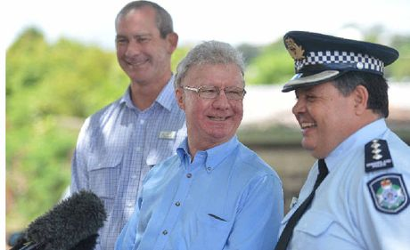VISIT: Queensland Governor Paul de Jersey (centre), Mayor Mick Curran and police inspector Jon Lewis share a laugh during yesterday's flood visit.