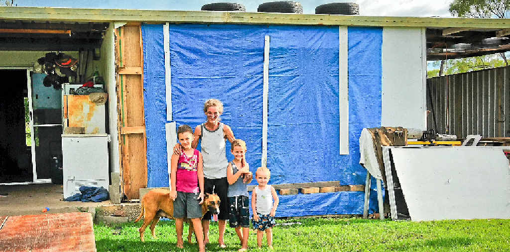 GONE WITH THE WIND: Patricia Brough and Declan, 7, Shannon, 5, and Chad Fall, 2, are disappointed they were told they were not eligible for disaster relief after Tropical Cyclone Marcia tore the front wall from of their Mt Larcom home.