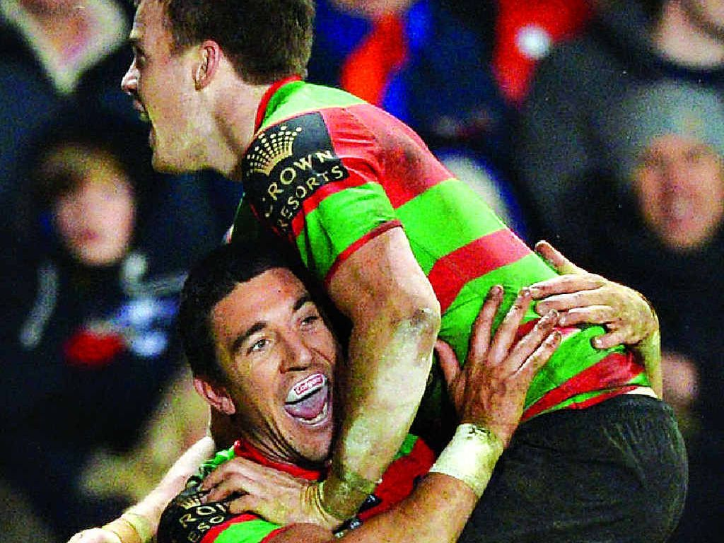 SEVENTH HEAVEN:Joel Reddy (left) celebrates with teammate Luke Keary after he scores Souths' seventh try against St Helens at Langtree Park.