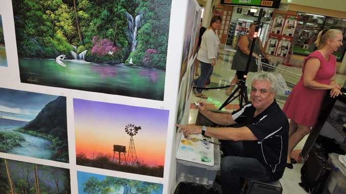 TV show Art Studio host Wayne Clements sets up his mobile studio for shoppers at Maryborough's Station Square.