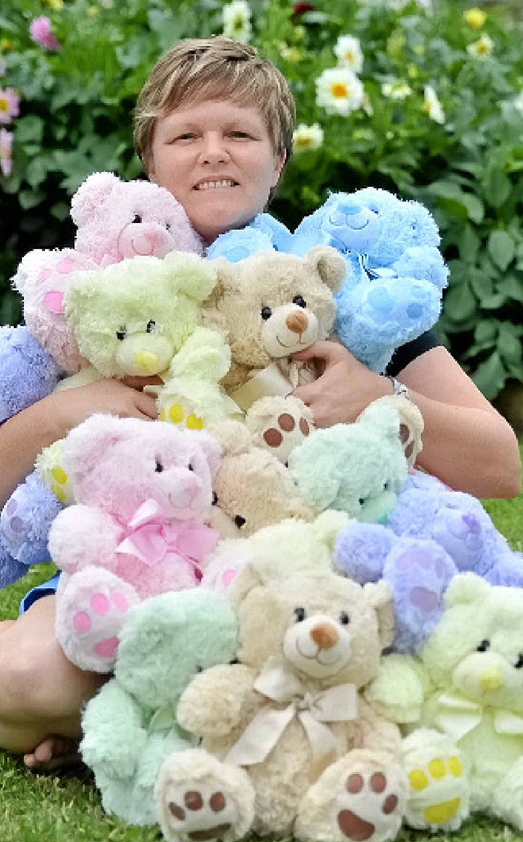 "STRONG STUFF: Helen Garrett with the teddy bears she ""adopts"