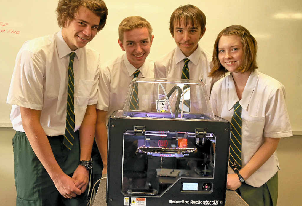 WORKING IN 3D: Senior graphics students Tom Wager, Lachlan Miners, Aayden Taylor and Peta Keller with the schools 3D printer.