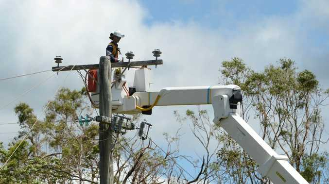 Ergon and Energex workers help restore power lines and poles along Adelaide Park Road Yeppoon after Cyclone Marcia left tens of thousands of homes without power across the region. Photo: Chris Ison / The Morning Bulletin