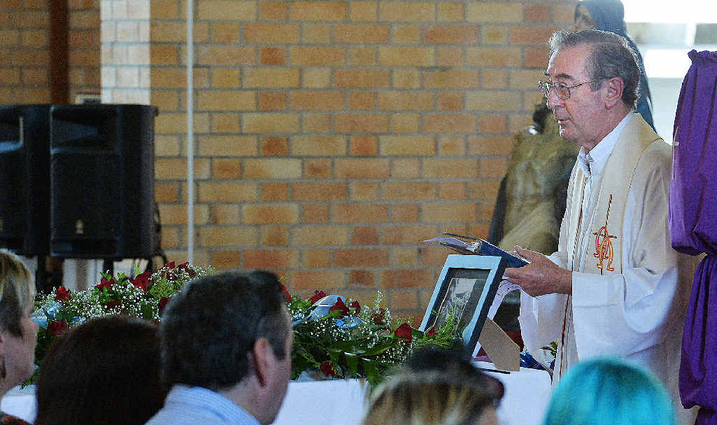 Fr Pat Mooney conducts the service at the funeral of Sarah Rigby.