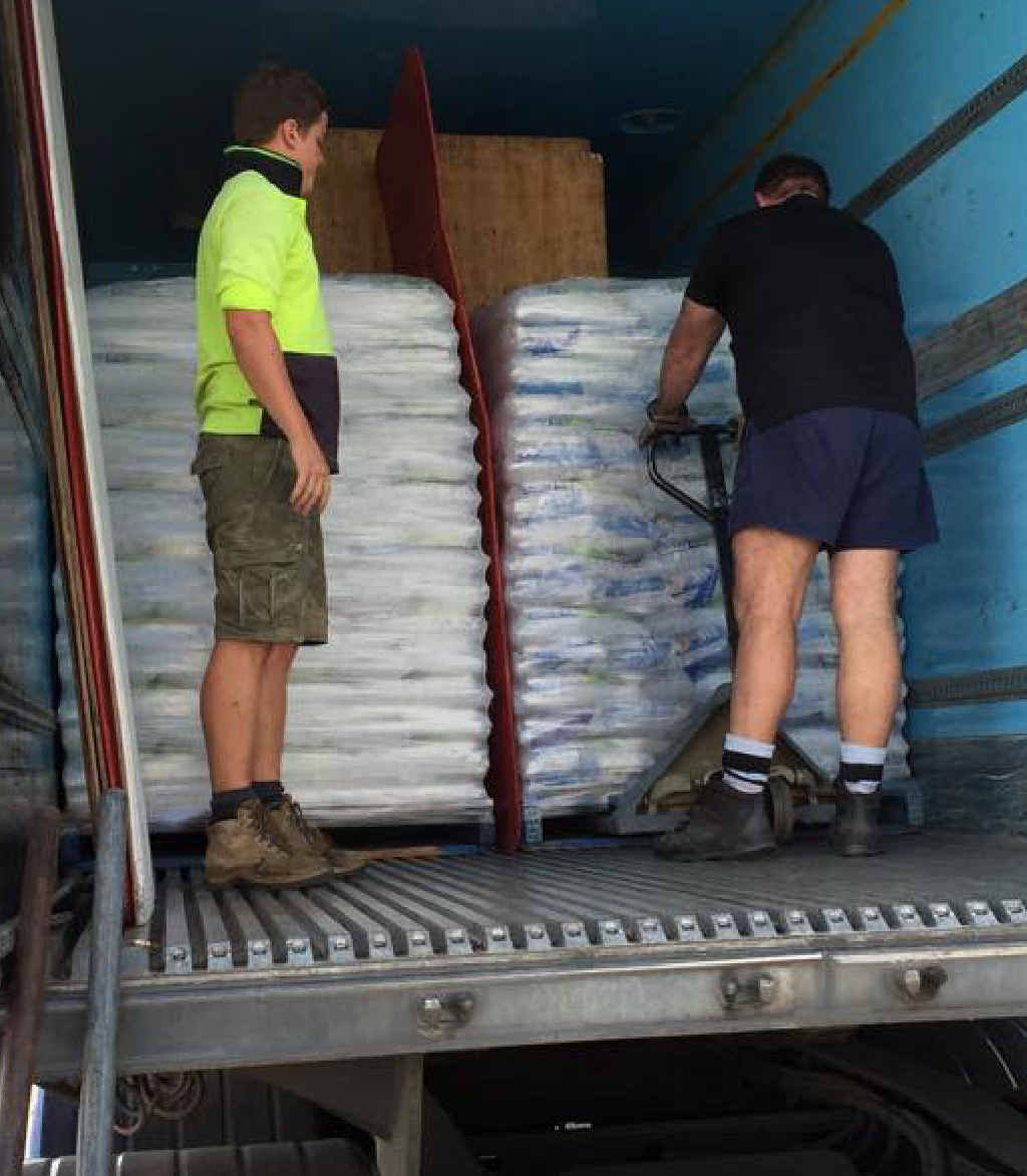 Southbound ice is loaded into a truck in Mackay.