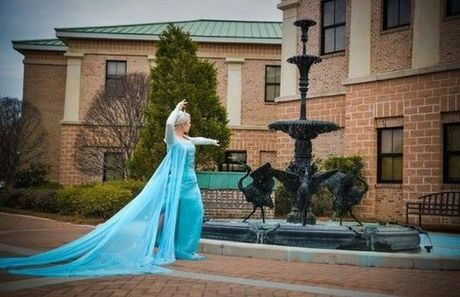 'Queen Elsa' from Disney's movie 'Frozen,' played by Courtney Fazley, is caught blue-handed attempting to freeze the town fountain in front of City Hall in Hanahan, South Carolina. Her chilly wickedness will not stand!