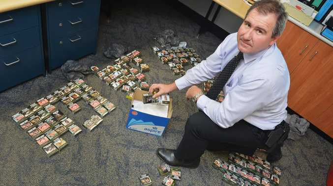 Gympie CIB, Detective Sargeant Rob Lowry with cigarette haul from Heilbronn's Store, Duke Street, Gympie. Photo: Greg Miller / Gympie Times