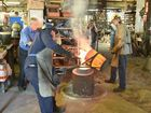 Peter Olds, Brady Yeates and Josh Ihle at the pouring of the bronze for a replica Maheno bell at Old's Engineering in Maryborough.