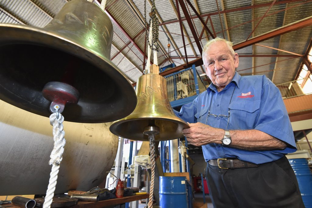 Old's Engineering chief executive Peter Olds with a new replica and the original Maheno bell.