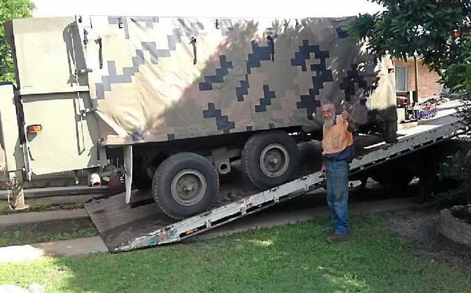 SNAPPY HELP: The boys at Rockhampton Heavy Towing helped move the generator.