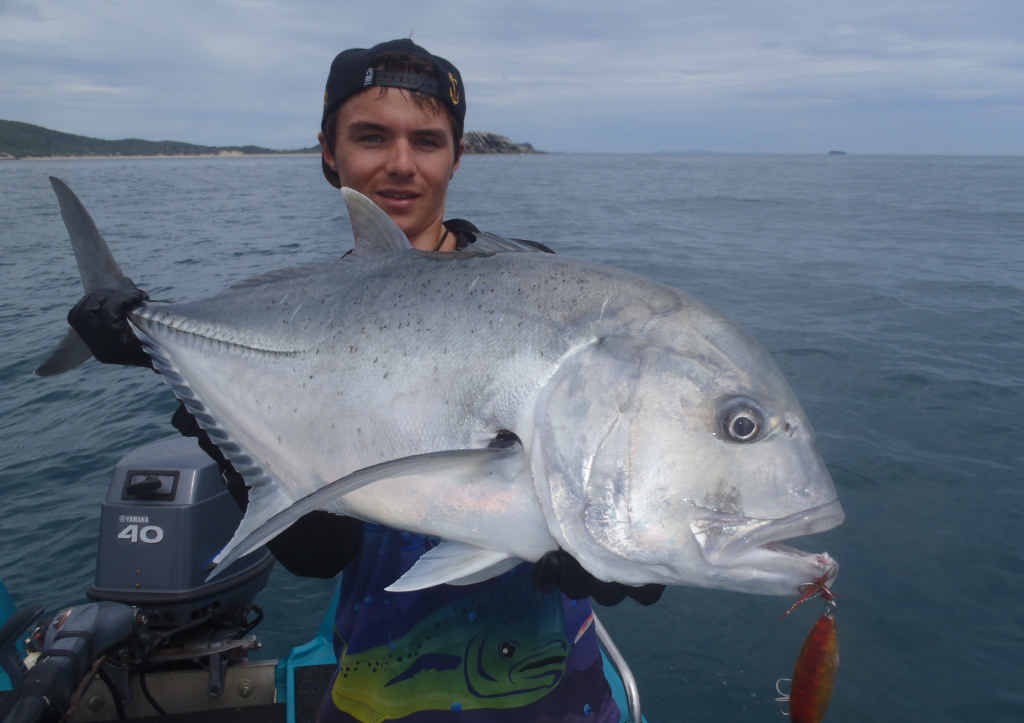 TERRIFIC TREVALLY: Coby Pascoe with a huge giant trevally, photographed then released.