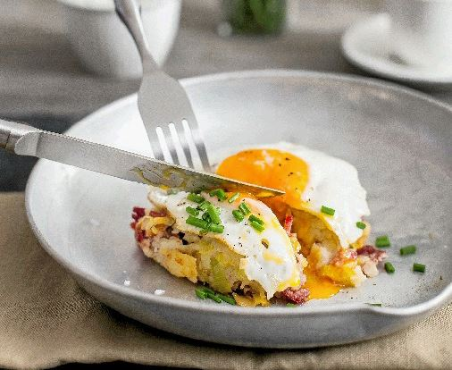Corn beef hash with fried egg and hollandaise. Glen David Wilson