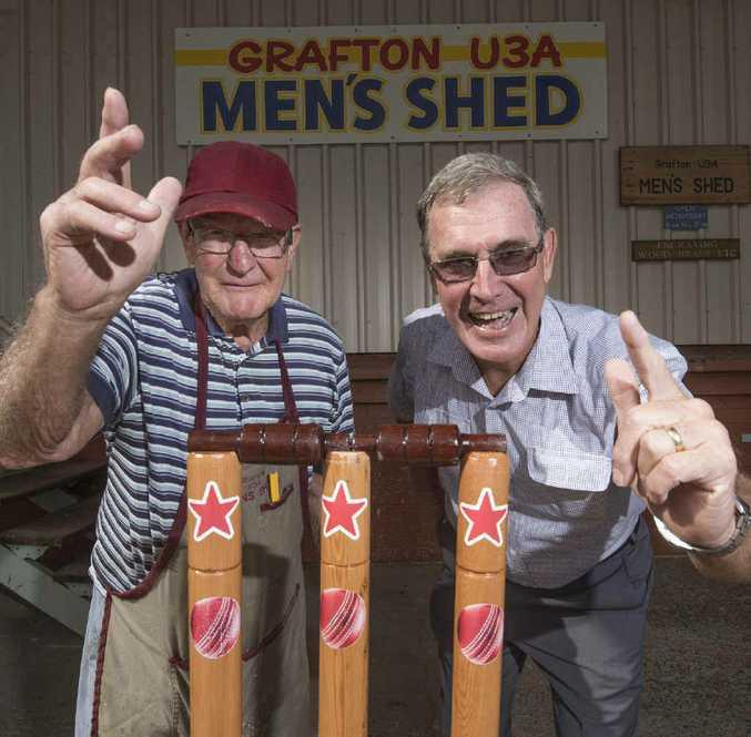 HOWZAT: Men's Shed memmber Kel Phelps with the stumps he made for Geoff Shepherd. Photo Adam Hourigan