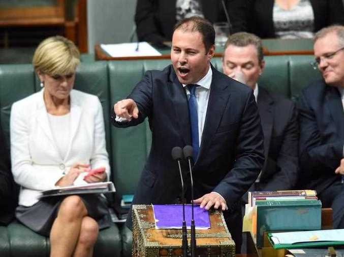 Foreign Minister Julie Bishop (left), Education Minister Christopher Pyne (second right) and Social Services Minister Scott Morrison (right) watch from the frontbench as Federal Assistant Treasurer Josh Frydenberg speaks and points at the opposition while at the despatch box during Question Time at Parliament House in Canberra, Monday, Feb. 23, 2015.