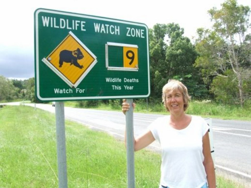 Jane Wickers with the Leftbank Road wildlife sign. Photo Contributed