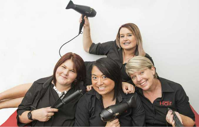 A CUT ABOVE: Katie Clair (back) and Maddie O'Connor, Meg Lamrock and Fran Eggins (right) of Red Hot Hair, named most popular hairdresser in Clarence Valley in a Daily Examiner Facebook poll. PHOTO: ADAM HOURIGAN