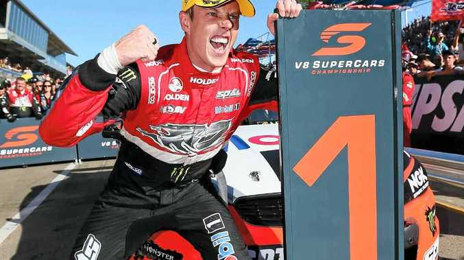 ALL SMILES: James Courtney celebrates after winning race three at the Clipsal 500.