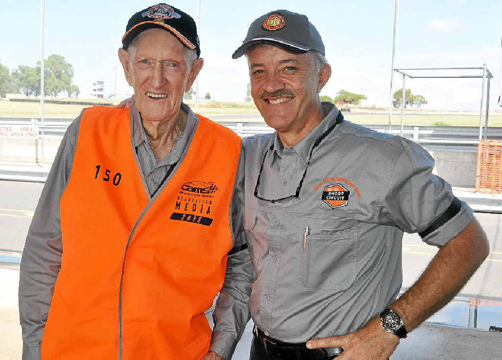 PAYING THEIR RESPECTS: Short Circuit Motorsport Association secretary Fred Berge and president Derek Pingel paid tribute to Bill Campbell with black armbands.