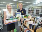 Tara Webb of Fraser Coast Libraries and Rotary Club of Hervey Bay Sunrise treasurer Tricia Wright ahead of last year's book sale.