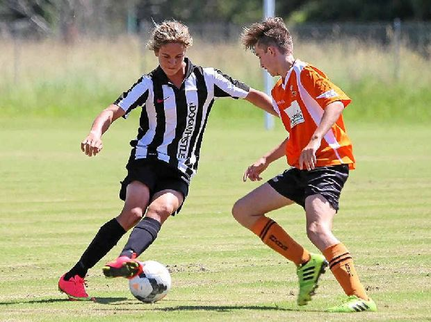 Byron's under-16 corner king Harrison Kent takes on the Lennox defence.