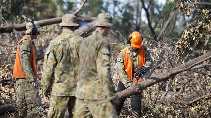 Australian Army Engineers from the 3rd Combat Engineers Regiment clear and remove debris at the Kershaw Botanic Gardens as part of the Engineer Support Group. *** Local Caption *** Teams of chainsaw operators from the Australian Army s Engineer Support Group (ESG) are continuing to make major inroads as part of the clean up effort in the wake of Cyclone Marcia. On 3d March 2015, a section of troops from the 3rd Combat Engineer Regiment (3 CER) descended on Rockhampton s Kershaw Gardens, to clear access paths and remove a significant number of fallen trees. The ESG has surged to almost 200 soldiers so it can further assist State Emergency Service personnel, local contractors and members of the community restore Rockhampton, Yeppoon and Byfield regions.