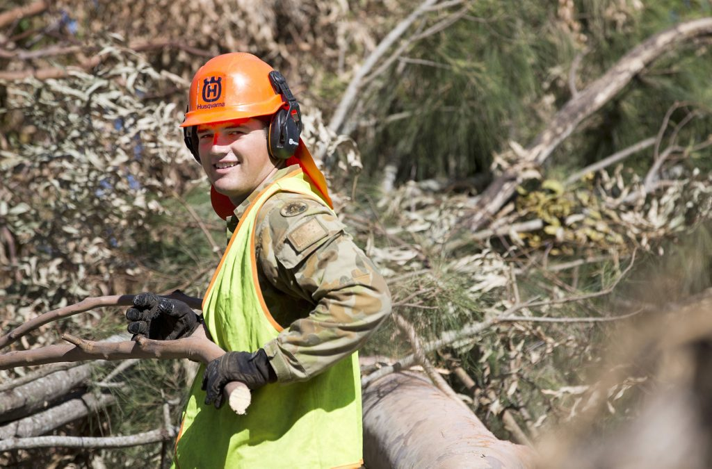 Australian Army Sapper Dominic Markut clears and removes debris at the Kershaw Botanic Gardens as part of the Engineer Support Group.