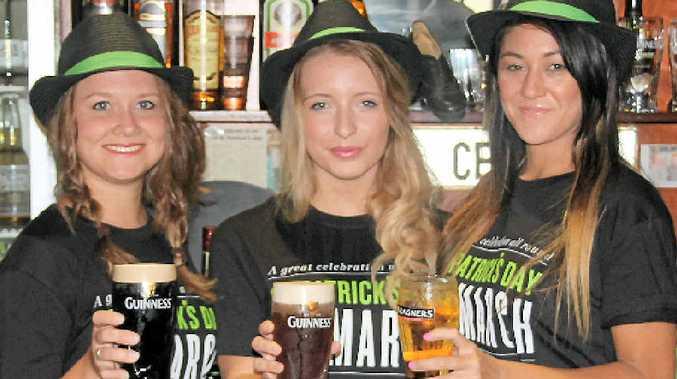 IRISH SPIRIT: O'Duinns Irish Pub staff Ine van Teeffelen, Meghan Dunne and Andy Chia.