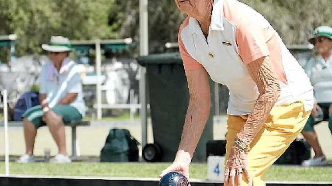 CONCENTRATION: Joy Jeffries lines up a bowl at the Proserpine Bowls Club on Sunday afternoon.