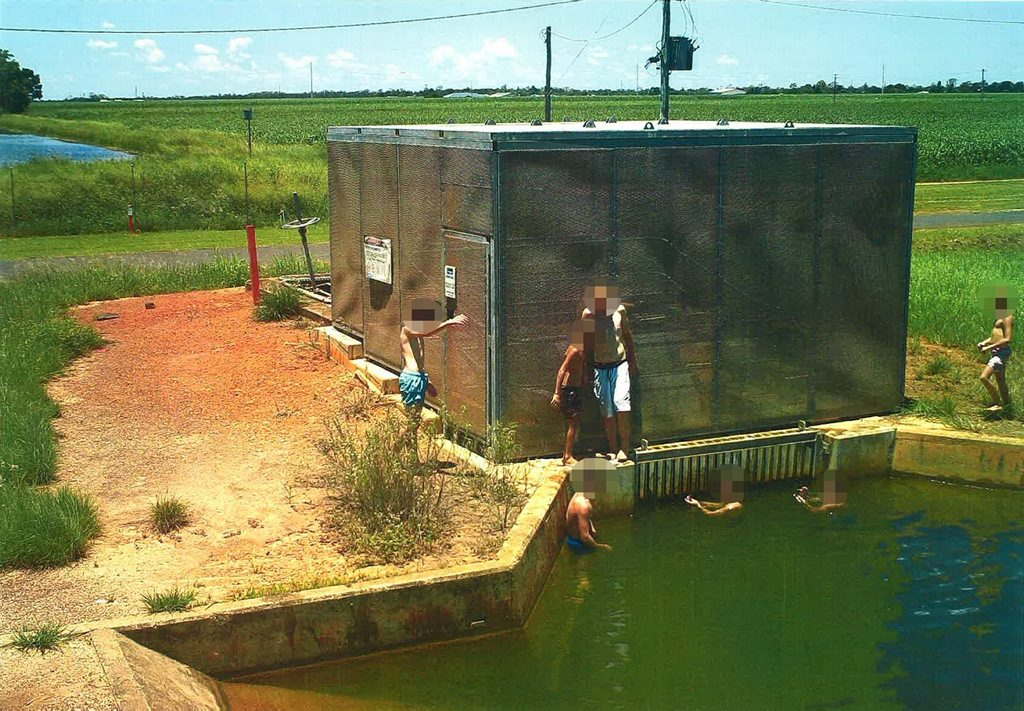Surveillance image of a group of children caught swimming around the regulating structure of the Woongarra Main Channel in Bundaberg. Photo: contributed
