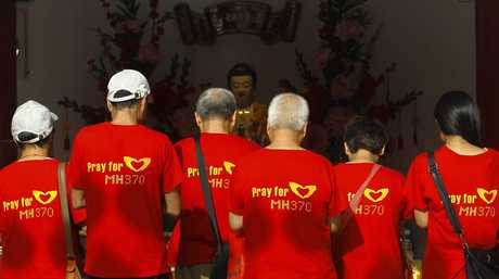 Relatives of Chinese passengers from the missing Malaysia Airlines flight MH370 attend prayers in Thean Hou temple, Kuala Lumpur, Malaysia, 01 March 2015. About two-thirds of the 239 passengers were Chinese nationals