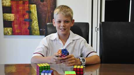 Josiah Eldridge, 12, can solve a Rubik's Cube in under one minute.