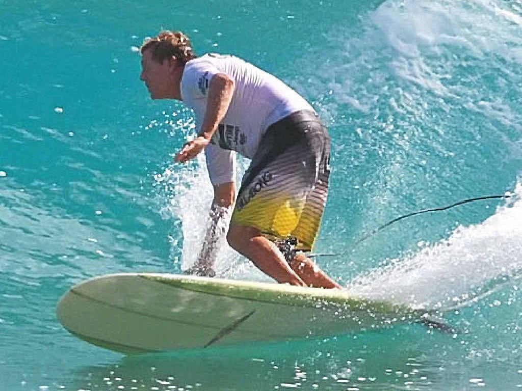 FEELING QUITE AT HOME: Reid Johnson heads for victory in the over-40 division at the Noosa Festival of Surfing.
