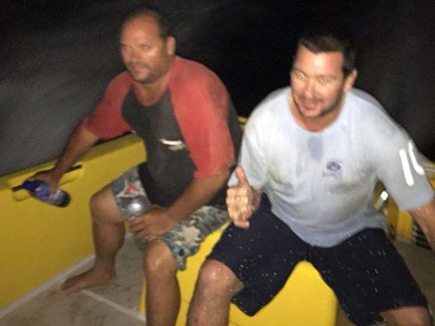LUCKY: Evans Head fishermen Brett McMahon and Glenn Deas on board the Ballina Jet Boat four hours after their trawler, the Coombell Star, capsized.