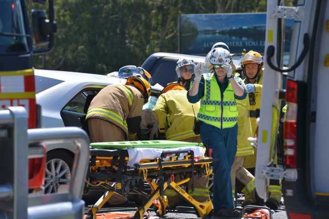 FATAL: Emergency workers hard at work trying to extricate 3 trapped passengers from a head-on accident Frizzo Road, Palmview. Photo: John McCutcheon / Sunshine Coast Daily