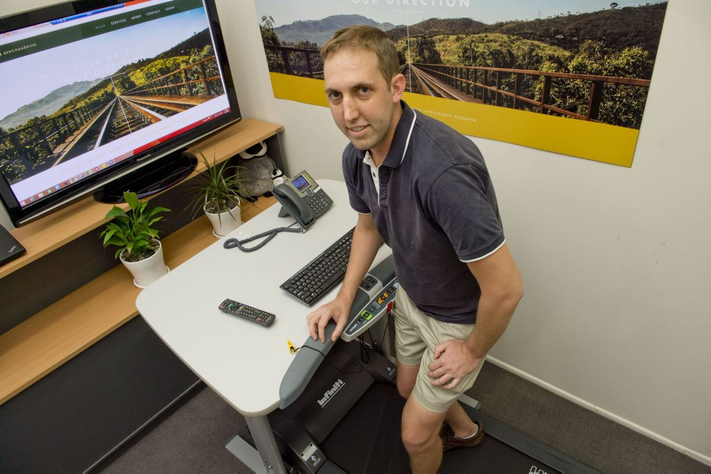 Steve Collier from MOA Benchmarking makes use of a treadmill desk to excercise and stay alert in the office.