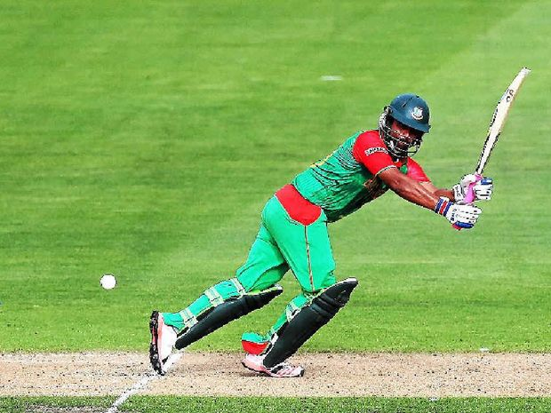 FOUR MORE: Tamim Iqbal of Bangladesh works the ball away for a boundary.