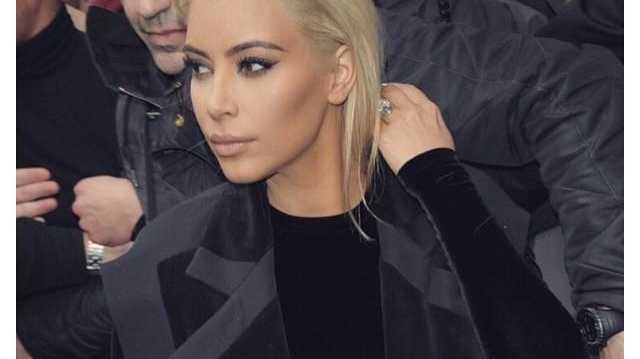 'Blonde at Balmain' Kim Kardashian wrote on her Facebook page.
