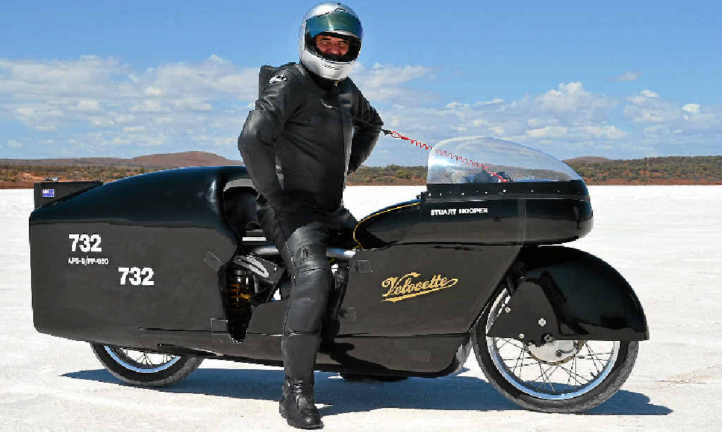 TOP GEAR: Yandina's Stuart Hooper with his world record-breaking Velocette at Lake Gairdner in South Australia.
