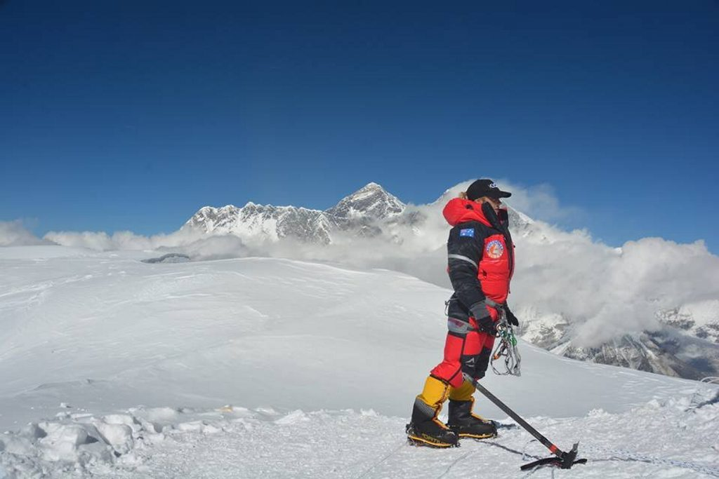 Alyssa Azar on the summit of Ama Dablam with Mount Everest rising in the background behind her. Photo Contributed