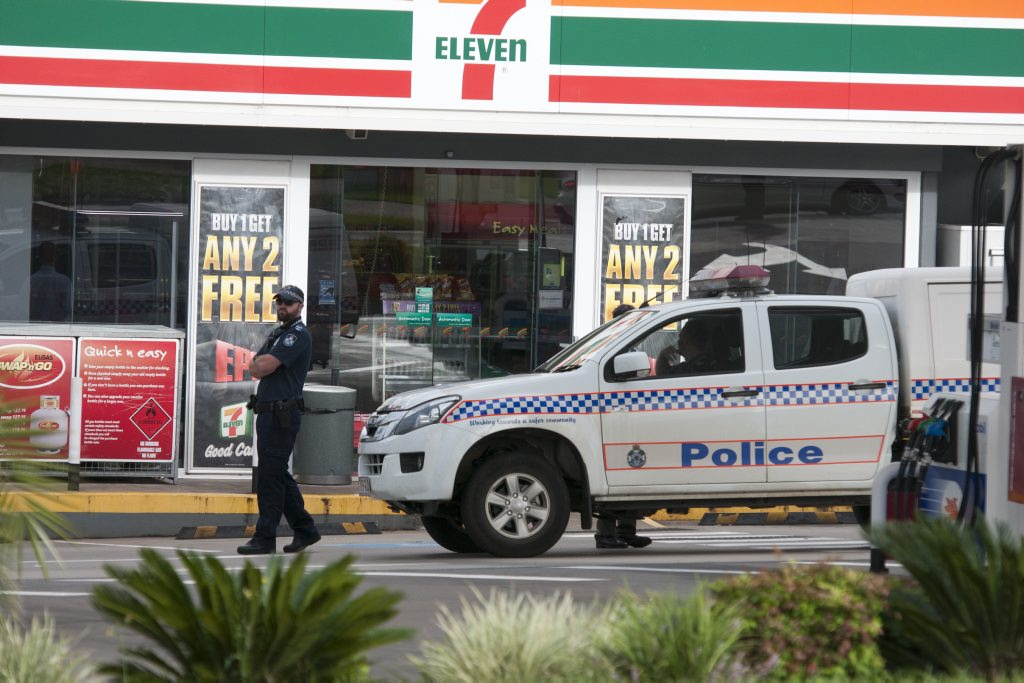 Police at the scene of a service station armed robbery.