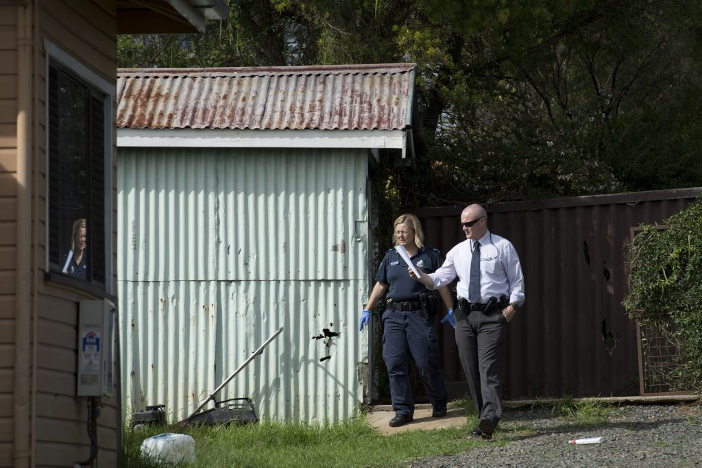 Police investigate a fire in a detached laundry of a North Toowoomba home.