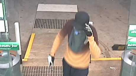 CCTV footage shows a man armed with a knife entering the 7-Eleven service station at the intersection of Mackenzie and Perth Sts.