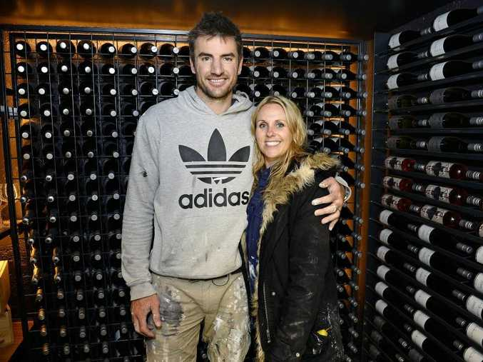 Darren and Deanne Jolly inside the wine cellar in their South Yarra apartment.