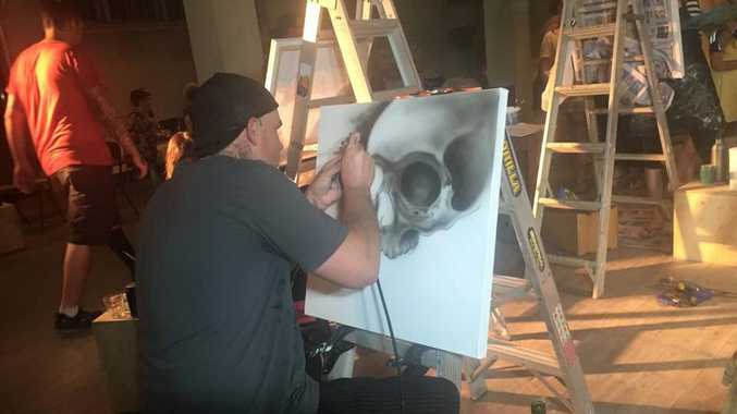 From tatoos to canvas, Jeremy Martin braves Rocky's first art battle. Photo Christine McKee / The Morning Bulletin
