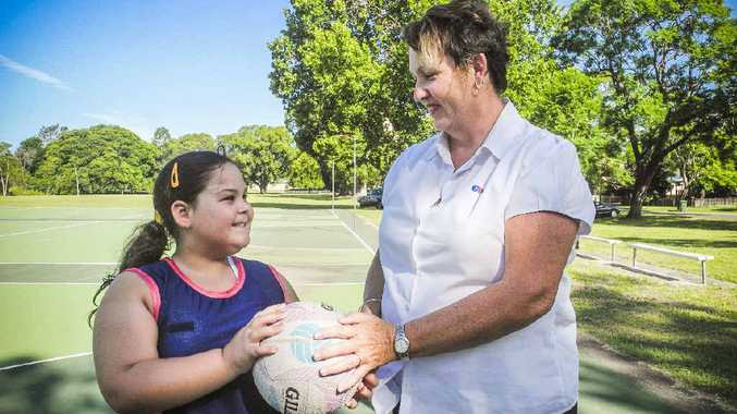 HAPPY TO PLAY: Kiara Perrette receives a ball and sponsorship from Northside Netball Club president Annette Lloyd. PHOTO: MARCO MAGASIC