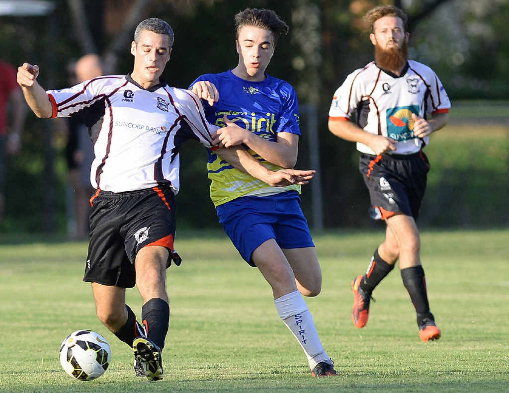 HANDY DEFENCE: An Ipswich City player shields the ball from a Western Spirit chaser during Saturday's Reserve grade local derby at Sutton Park. Ipswich City won 3-2 before Spirit triumphed 1-0 in the main game.
