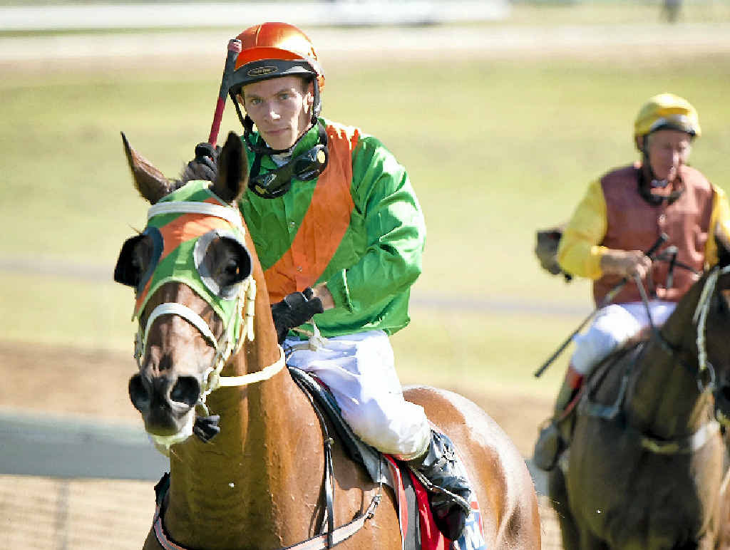 TIP OF THE CAP: Jockey Lachlan Dodds returning to the mounting yard after scoring his first ever race win aboard classy horse Schoorwin.